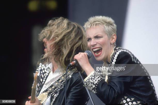Dave Stewart and Annie Lennox of Eurythmics perform in Pearly King and Queen outfits, circa 1989.