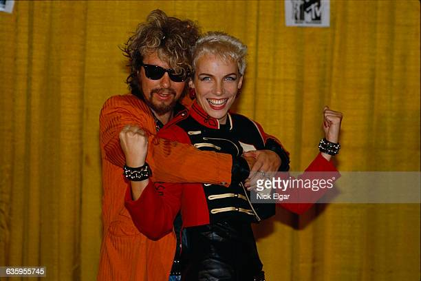 Dave Stewart and Annie Lennox of the Eurythmics pose together at an event in 1985