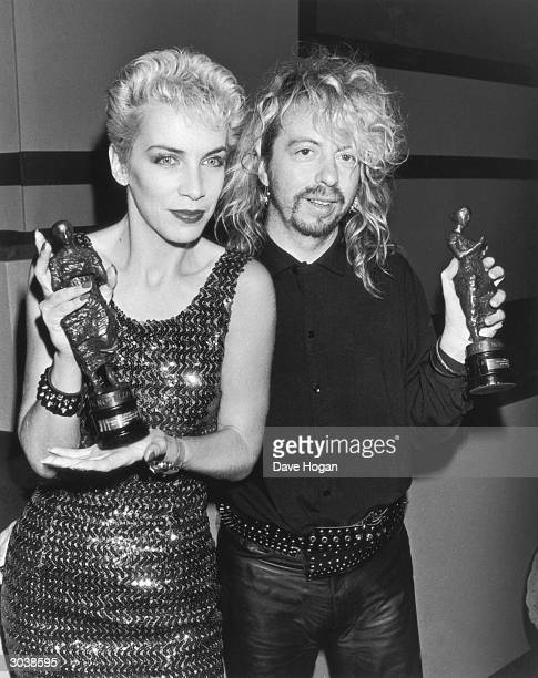 Dave Stewart and Annie Lennox of the Eurythmics with their Ivor Novello awards for Best Contemporary Song and Songwriters of the Year 15th April 1987