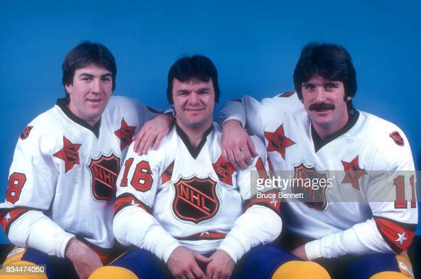 Dave Taylor Marcel Dionne and Charlie Simmer of the Los Angeles Kings known as the Triple Crown Line pose in their 1981 NHL AllStar jerseys prior to...