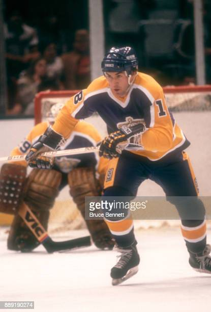 Dave Taylor of the Los Angeles Kings skates on the ice during an NHL game against the New York Islanders circa 1982 at the Nassau Coliseum in...