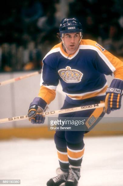 Dave Taylor of the Los Angeles Kings skates on the ice during an NHL game against the New York Islanders on October 16 1982 at the Nassau Coliseum in...