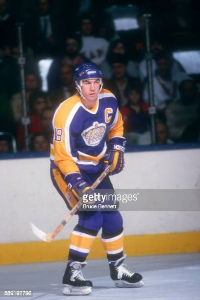 Dave Taylor of the Los Angeles Kings skates on the ice during an NHL game against the New York Islanders on November 17 1987 at the Nassau Coliseum...