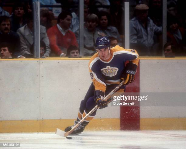 Dave Taylor of the Los Angeles Kings skates with the puck during an NHL game against the New Jersey Devils on February 14 1984 at the Brendan Byrne...