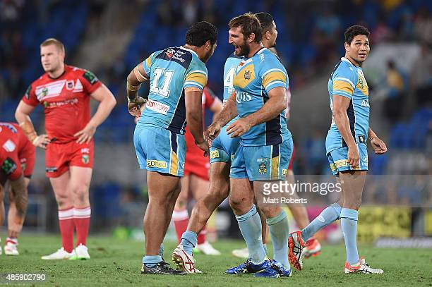 Dave Taylor of the Titans celebrates victory with team mates during the round 25 NRL match between the Gold Coast Titans and the St George Illawarra...