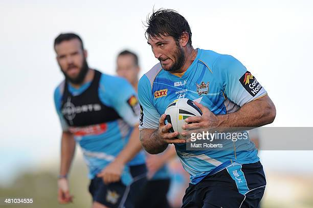 Dave Taylor runs with the ball during a Gold Coast Titans NRL training session at Tugun Rugby League Field on March 28 2014 on the Gold Coast...