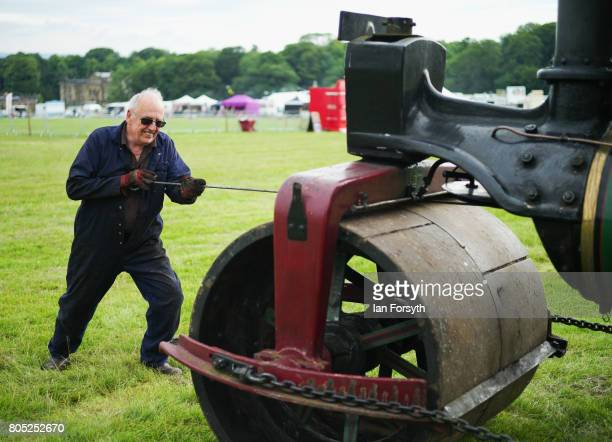 Dave Tesseyman from Boroughbridge cleans the tubes on his 1931 steam engine 'Ruby' during the Duncombe Park Steam Rally on July 1 2017 in Helmsley...