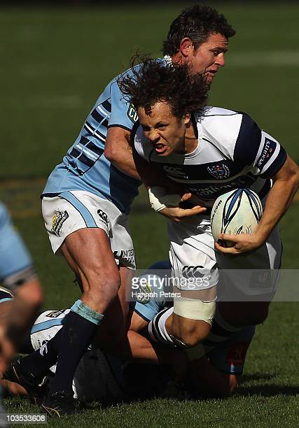 Dave Thomas of Auckland is tackled hard by David Holwell of Northland during the round four ITM Cup match between Auckland and Northland at Eden Park...