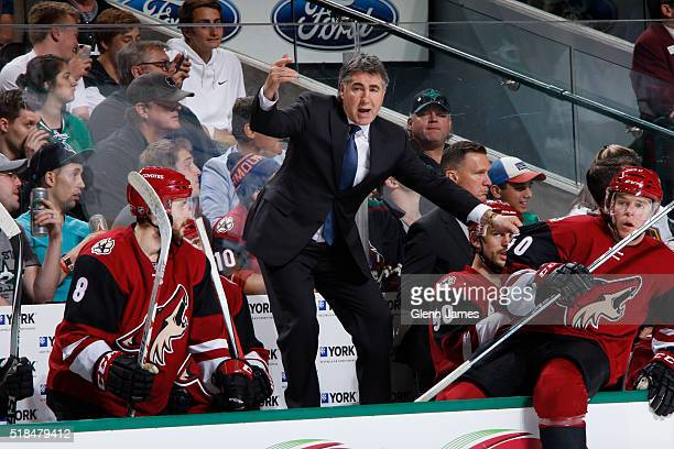 Dave Tippett head coach of the Arizona Coyotes yells to his players from the bench against the Dallas Stars at the American Airlines Center on March...