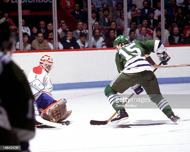 Dave Tippett of the Hartford Whalers attempts to knock the loose puck in the net during a game against the Montreal Canadiens Circa 1985 at the...