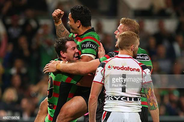Dave Tyrrell and Isaac Luke of the Rabbitohs celebrate after scoring a try during the round 13 NRL match between the South Sydney Rabbitohs and the...