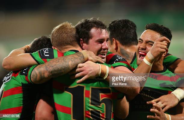 Dave Tyrrell of the Rabbitohs is congratulated by team mates after crossing for a try during the round 13 NRL match between the South Sydney...