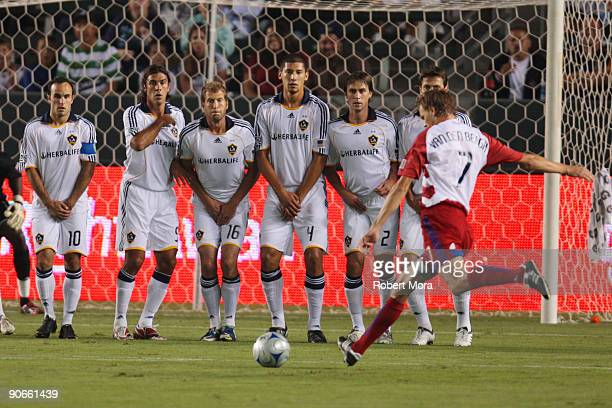 Dave Van Den Bergh of FC Dallas heads takes a free kick against the defense of the Los Angeles Galaxy during their MLS game at The Home Depot Center...