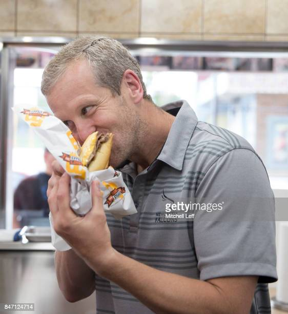 Dave Walder of the Newcastle Falcons takes a bite of his cheesesteak at Geno's Steaks on September 14 2017 in Philadelphia Pennsylvania
