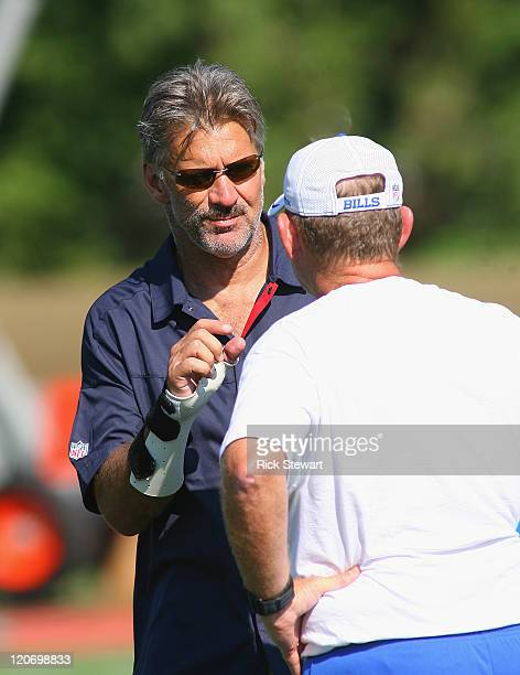 Dave Wannstedt Assistant head coach/linebackers coach of the Buffalo Bills talks to Head coach Chan Gailey during Buffalo Bills Training Camp at St...