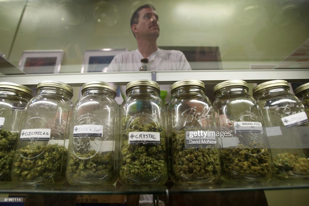 Dave Warden, a bud tender at Private Organic Therapy (P.O.T.), a non-profit co-operative medical marijuana dispensary, displays various types of marijuana available to patients on October 19, 2009 in Los Angeles, California. Attorney General Eric Holder announced new guidelines today for federal prosecutors in states where the use of marijuana for medicinal purposes is allowed under state law. Federal prosecutors will no longer trump the state with raids on the southern California dispensaries as they had been doing, but Los Angeles County District Attorney Steve Cooley recently began a crackdown campaign that will include raids against the facilities. Cooley maintains that virtually all marijuana dispensaries are in violation of the law because they profit from their product. The city of LA has been slow to come to agreement on how to regulate its 800 to 1,000 dispensaries. Californians voted to allow sick people with referrals from doctors to consume cannabis with the passage of state ballot Proposition 215 in 1996 and a total of 14 states now allow the medicinal use of marijuana.