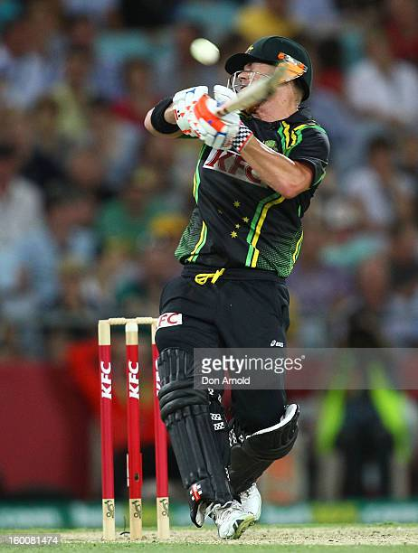 Dave Warner hooks Angelo Mathews for six during game one of the Twenty20 international match between Australia and Sri Lanka at ANZ Stadium on...