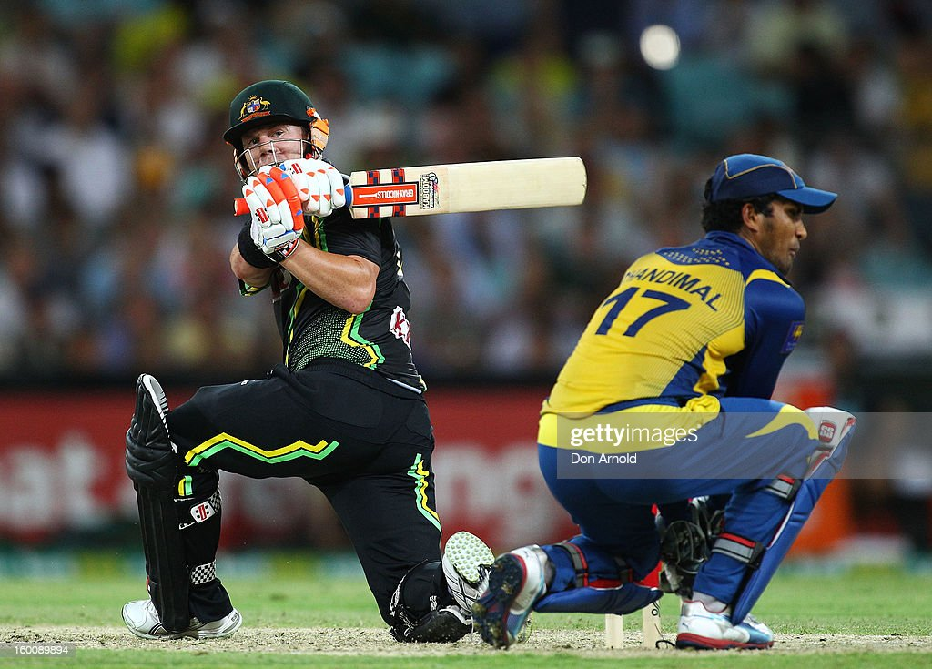 Dave Warner of Australia attempts a reverse sweep during game one of the Twenty20 international match between Australia and Sri Lanka at ANZ Stadium on January 26, 2013 in Sydney, Australia.
