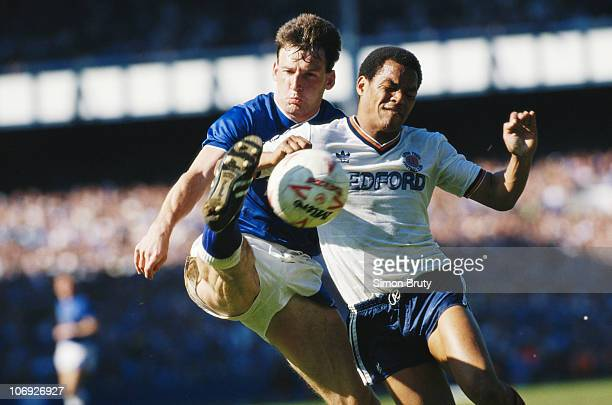 Dave Watson of Everton FC challenges Brian Stein of Luton Town FC during their League Division One match on 9th May 1987 at Goodison Park England