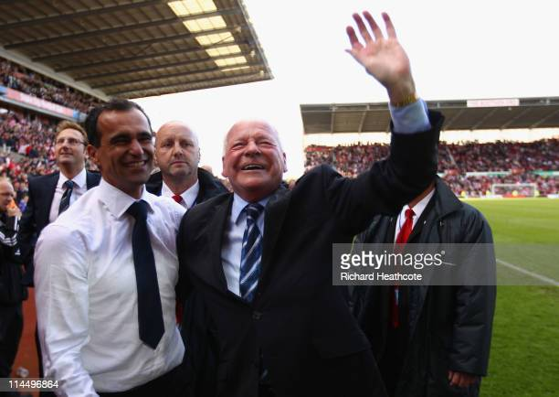Dave Whelan Chairman of Wigan Athletic and manager Roberto Martinez celebrate after winning 10 to keep them in the Premiere League during the...