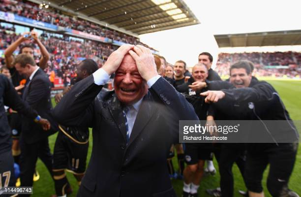 Dave Whelan Chairman of Wigan Athletic is soaked with champagne after winning 10 to keep them in the Premiere League during the Barclays Premier...