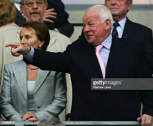 Dave Whelan, Chairman of Wigan Athletic shares a joke during the Barclays Premiership match between Wigan Athletic and Middlesbrough at the JJB...