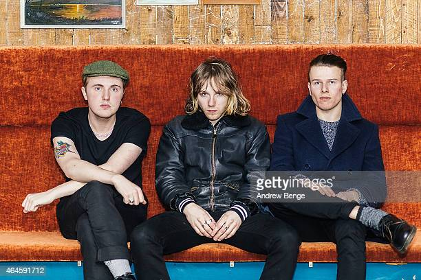 Dave Williams, Nathan Day and Jack Bentham of Darlia pose back stage at The Wardrobe on February 24, 2015 in Leeds, United Kingdom.