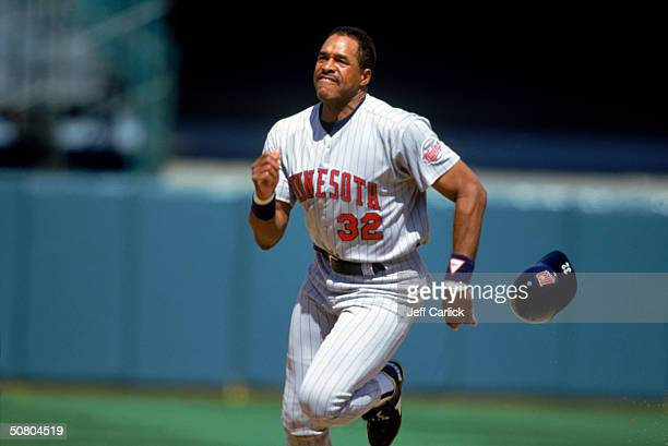 Dave Winfield of the Minnesota Twins loses his helmet as he runs hard to base during a game Winfield played for the Twins in 1993 and 1994