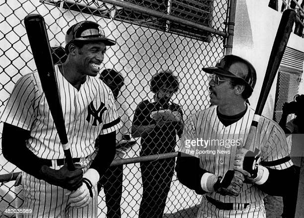 Dave Winfield of the New York Yankees jokes with Reggie Jackson circa 1980s