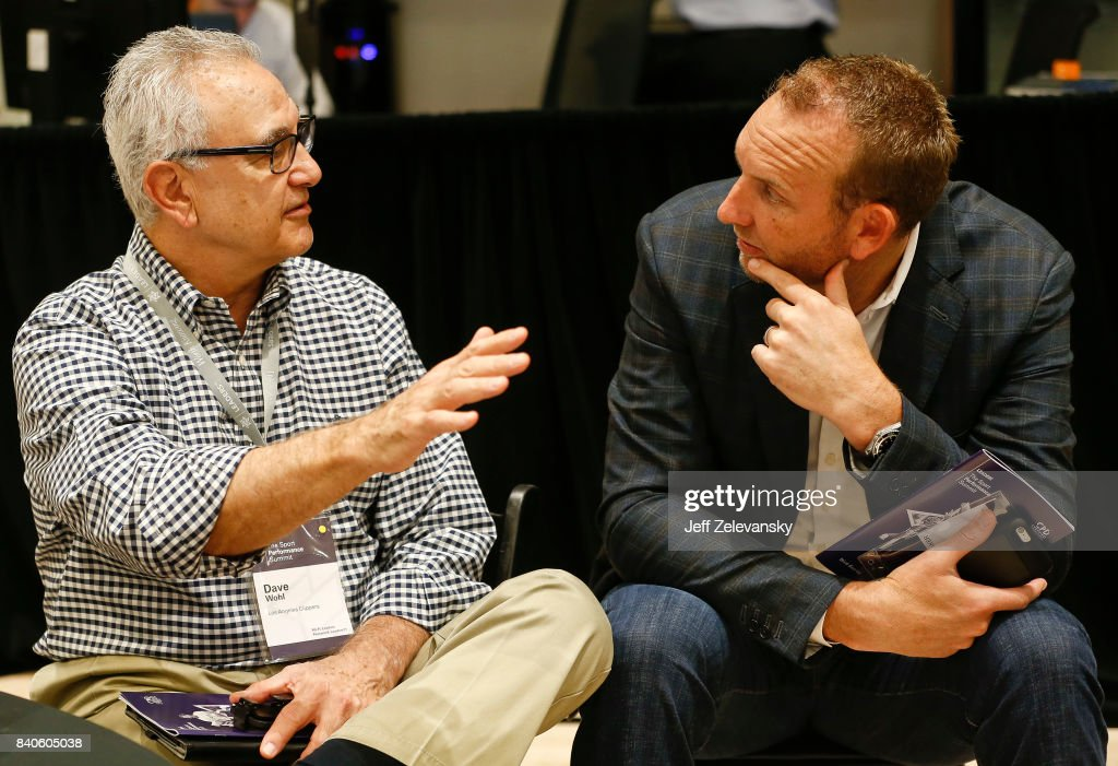 Dave Wohl (L), general manager of the Los Angeles Clippers, speaks with Sean Marks, general manager of the Brooklyn Nets during the Leaders Sport Performance Summit on August 29, 2017 in New York City.