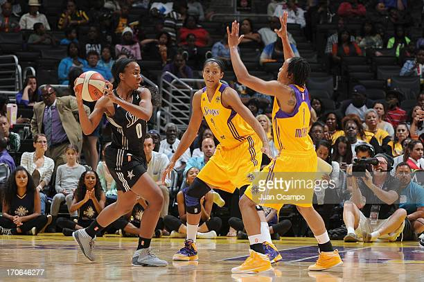 Davellyn Whyte of the San Antonio Silver Stars drives against Candace Parker and A'dia Mathies of the Los Angeles Sparks during the game at Staples...