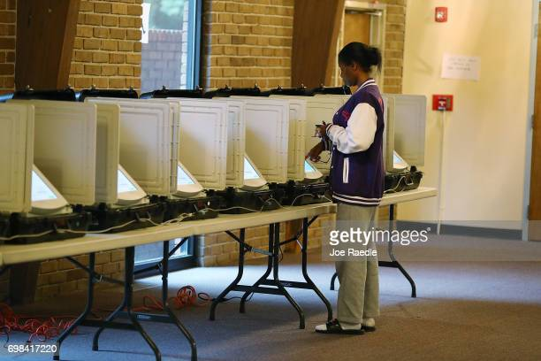 Daveta Mahoney casts her ballot during a special election in Georgia's 6th Congressional District special election at St Bede's Episcopal Church on...