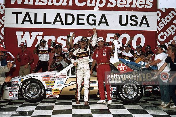 Davey Allison and his crew celebrate in victory lane following their win in the Winston 500 at Alabama International Motor Speedway It was AllisonÕs...