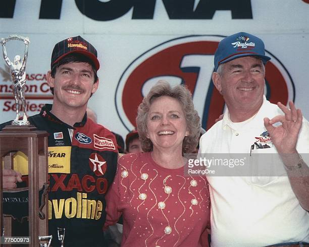 Davey Allison driver of the Robert Yates Racing TexacoHavoline Ford celebrates with his dad Bobby and mom Judy after winning the 1992 NASCAR Winston...