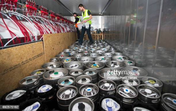 Davey Blackmon left and Jared Maruhnic of Marshall Wharf Brewing Co encase keg couplers in bubble wrap within the Maine Beer Box prior to being...