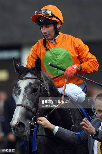 Davey Bonilla and Marchand d' Or return after landing The Darley July Cup Race run at Newmarket Racecourse July 11 2008 in Newmarket England