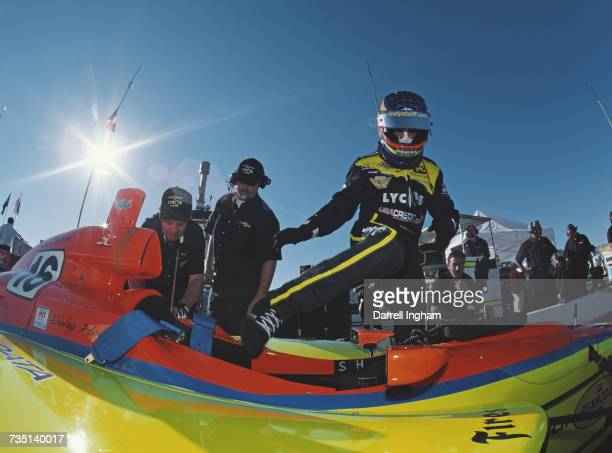 Davey Hamilton of the United States climbs aboard the Mid America Motorsports Dallara IR00 Oldsmobile Aurora V8 in the pits during practice for the...