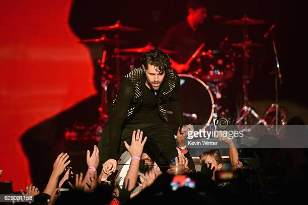 Davey Havok of the band AFI interacts with the audience at 1067 KROQ Almost Acoustic Christmas 2016 Night 1 at The Forum on December 10 2016 in...