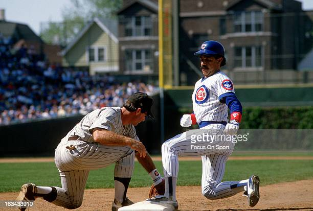 Davey Lopes of the Chicago Cubs gets back to first base beating the tag of Steve Garvey of the San Diego Padres during an Major League Baseball game...