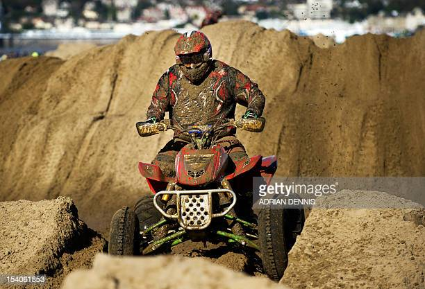 Davey Nixon rides his quad bike through the dunes during the main quad and sidecar race during the 2012 RHL Weston beach race in WestonSuperMare...
