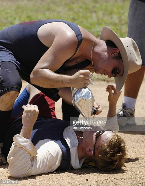 Davey Rowllison of the team 'Joes' recieves a 'layback' from teammate Doug Babarovich during the Goldfield Ashes January 27 2007 in Charters Towers...