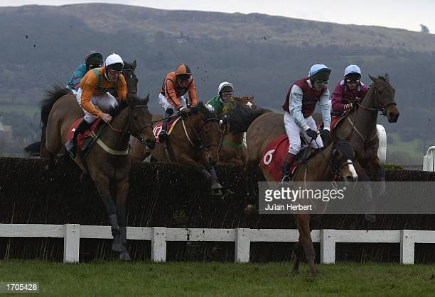 Davey Russell and Historg clear an early fence before landing The Racecourse Of The Year Handicap Steeple Chase race run at Cheltenham Racecourse on...