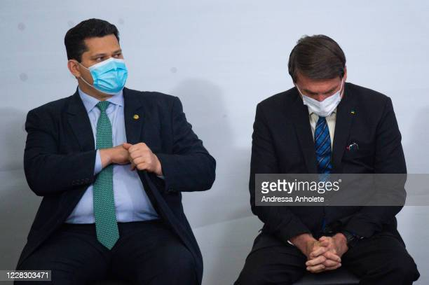 Davi Alcolumbre, President of the Brazil Senate looks on as Jair Bolsonaro, President of Brazil, reacts during launch of the Programa Norte Conectado...