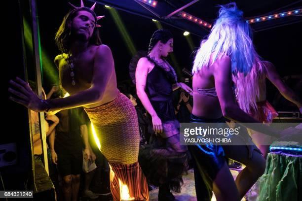 Davi de Oliveira Moreira known as Sereio dances at the Mermaids of Guanabara Bay party in Rio de Janeiro Brazil on May 7 2017 The 22yearold Brazilian...