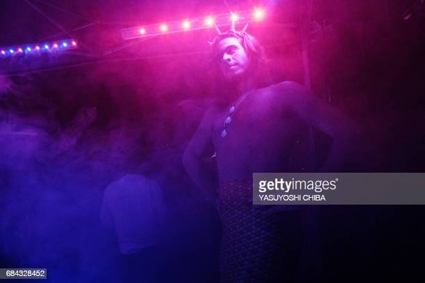 Davi de Oliveira Moreira known as Sereio dances during the Mermaids of Guanabara Bay party in Rio de Janeiro Brazil on May 7 2017 The 22yearold...