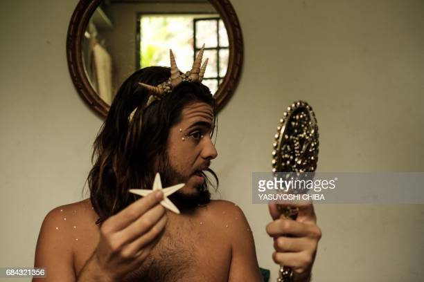 Davi de Oliveira Moreira known as Sereio gets ready at home putting on makeup and shells before leaving for Ipanema Beach in Rio de Janeiro Brazil on...
