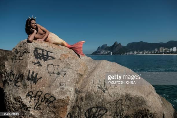Davi de Oliveira Moreira known as Sereio poses in his mermaid tail costume at Arpoador Rock on Ipanema Beach in Rio de Janeiro Brazil on May 3 2017...