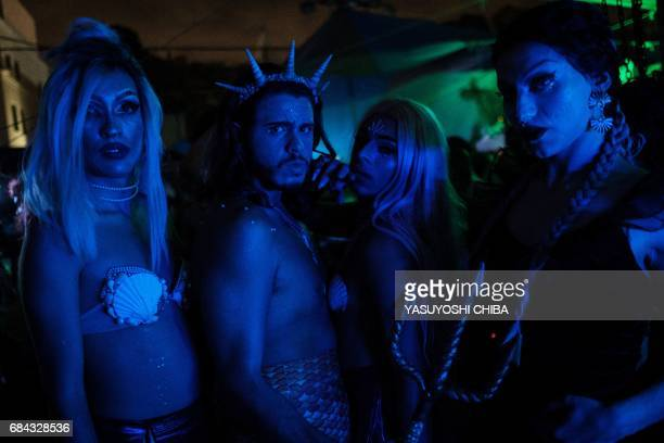 Davi de Oliveira Moreira known as Sereio poses with his friends at the Mermaids of Guanabara Bay party in Rio de Janeiro Brazil on May 7 2017 The...