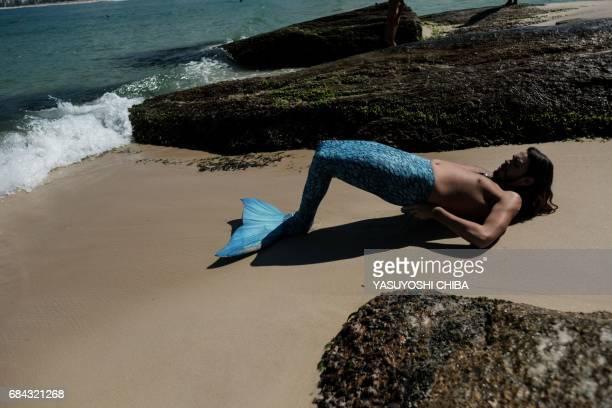 Davi de Oliveira Moreira known as Sereio puts on a blue mermaid tail to swim at Ipanema Beach in Rio de Janeiro Brazil on May 3 2017 The 22yearold...