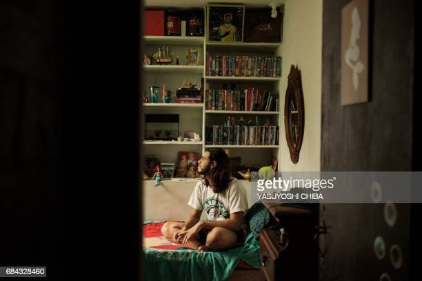 Davi de Oliveira Moreira known as Sereio sits on his bed at his home in Rio de Janeiro Brazil on May 3 2017 The 22yearold Brazilian is part of a...